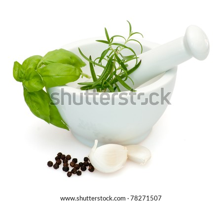 Preparation of marinade in Mortar - Salt, Rosemary, basil, garlic and pepper - with clipping path - stock photo