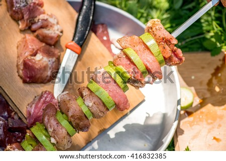 Preparation of meat skewers for barbeque - selective focus, copy space