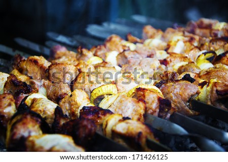 Preparation of meat slices with onion on fire - stock photo