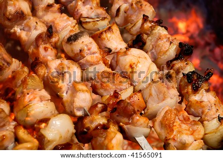 Preparation of meat slices with vegetables in sauce on fire - stock photo