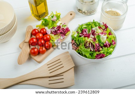 Preparation of mixed vegetable salad, lots of vegetable and seeds, bio healthy - stock photo