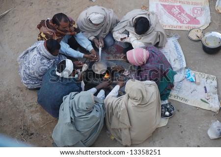 preparation of morning tea at tea shop, pushkar - stock photo