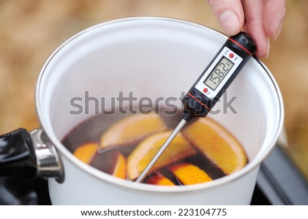 Preparation of mulled wine in the open air - stock photo