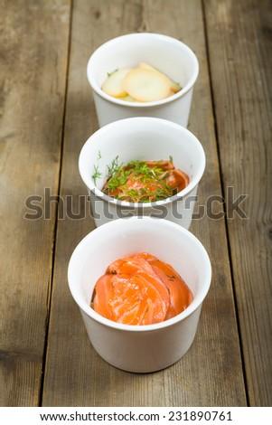 Preparation of the Swedish food luxpudding - baked salmon with potato - stock photo