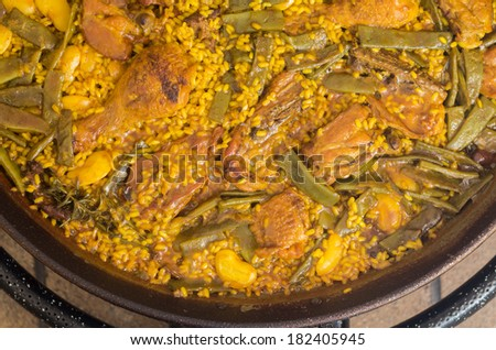 Preparation step of authentic Paella Valenciana Chicken, rabbit and vegetables - stock photo