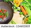 Preparation to asian traditional cooking. Wok and vegetables. - stock photo
