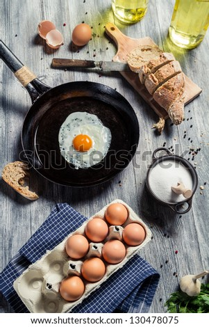 Preparations for breakfast made up of eggs - stock photo