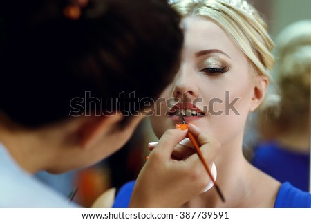 Preparations for the wedding, happy bride in a beauty salon