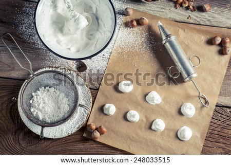 Prepare a baking homemade macaroons - stock photo