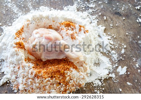 Prepare chicken mixed with flour and spices spicy. - stock photo