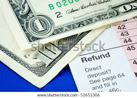 Prepare money to pay tax for the income tax returns - stock photo