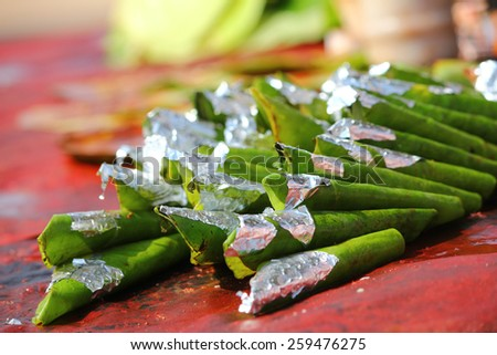 Prepared and decorated Betel leaves (Piper Betle). Betel leaves are mixed with ground nuts and optionally tobacco. Also called Paan, is popular across India as mouth freshener. - stock photo