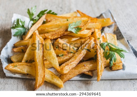Prepared and served french fries on the table,selective focus - stock photo