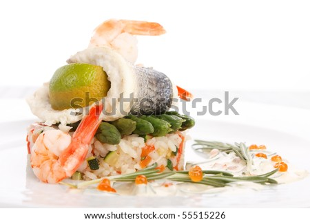 prepared fish with rice and vegetables - stock photo