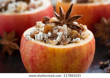 prepared for baking stuffed apples on a black background, close-up, horizontal - stock photo