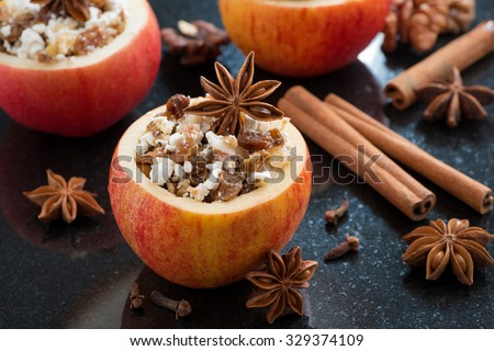 prepared for baking stuffed apples on a black background, horizontal - stock photo