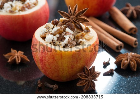 prepared for baking stuffed apples on a black background, horizontal, close-up - stock photo