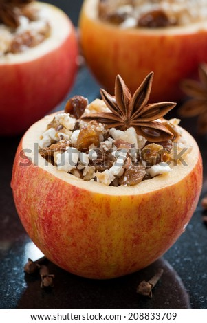prepared for baking stuffed apples on a black background, vertical - stock photo