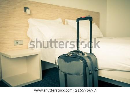 Prepared fresh bed, scene in hotel room. Horizontal retro toned shot - stock photo