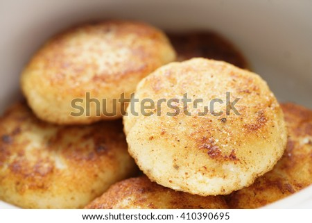 prepared fried fish cakes in bowl, shallow focus - stock photo