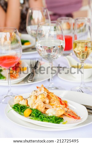 Prepared lobster on plate - stock photo