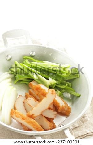 prepared onion, pepper and fish cake - stock photo