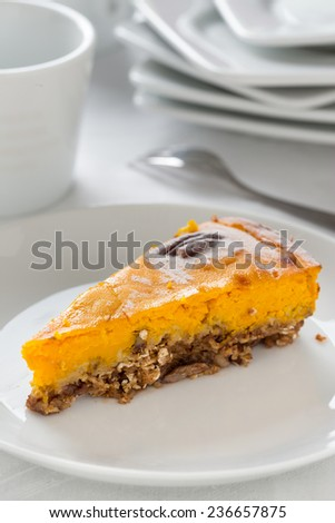 prepared pumpkin pie with pecan nuts. Vertical image. - stock photo