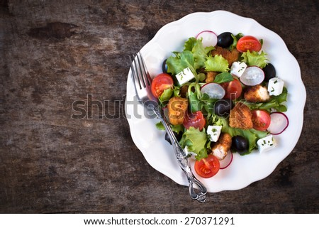 Prepared salad in the plate with fried chicken meat and vegetables,selective focus and blank space  - stock photo