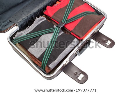 Prepared suitcase with clothing in holiday trip. Close up on white background. - stock photo