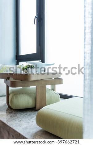 Prepared tea ceremony in a window niche bright lighted  - stock photo