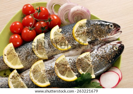 prepared trout fish with lemon and vegetables - stock photo