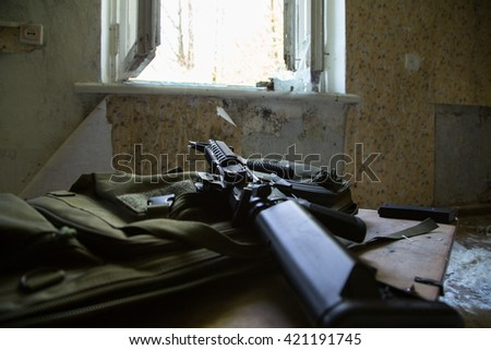 prepared weapons, abandoned house ruined, building, mess, interior - stock photo