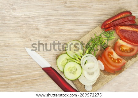 Preparing a delicious dinner. Homework vegetable salad. Ceramic paring knife. - stock photo