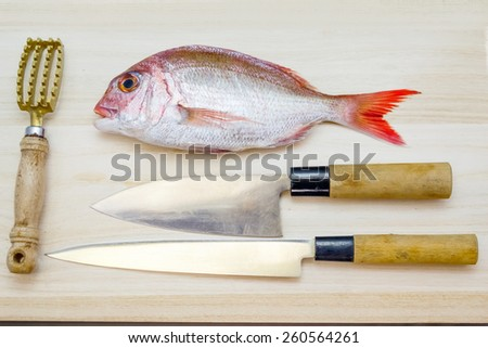 Preparing a sea bream in the Japanese style - stock photo