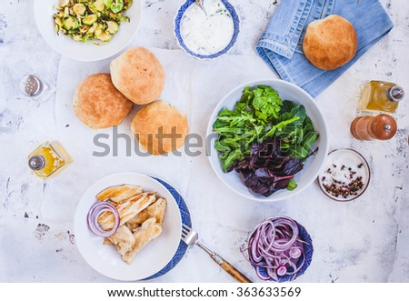 Preparing chicken burger with veggies for lunch family. - stock photo
