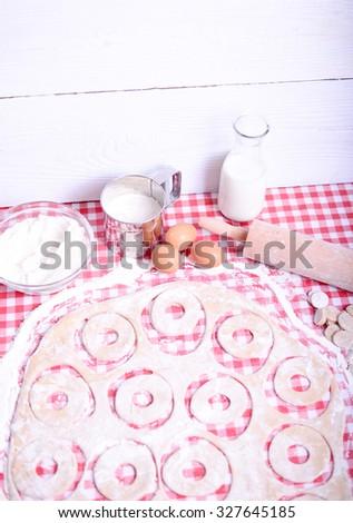 Preparing donuts in kichen  - stock photo