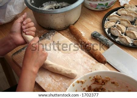 preparing dumpling dough, focus on tools - stock photo