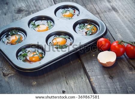 preparing egg muffins - stock photo