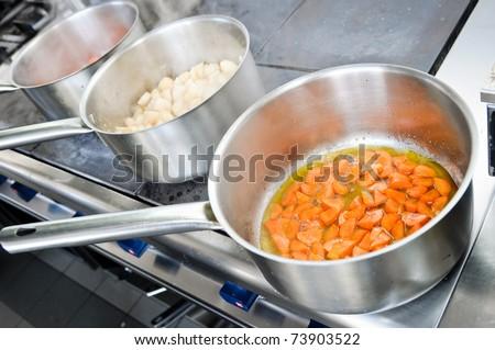 Preparing food at professional kitchen - stock photo