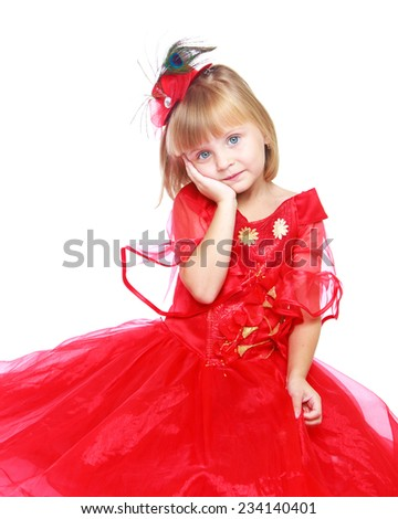 Preparing for Christmas, holiday, baby joy concept .Charming little girl in a bright red dress.Isolated on white background. - stock photo
