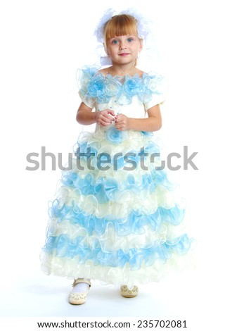Preparing for Christmas, holiday, baby joy concept .charming little girl in a long dress.Isolated on white background. - stock photo