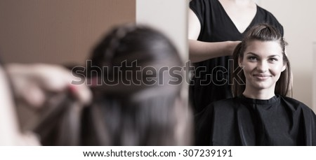 Preparing for important meeting in hairdresser salon - stock photo
