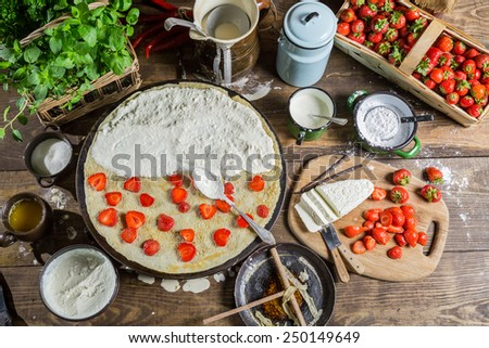 Preparing for pancakes with strawberry - stock photo