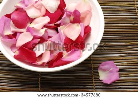 Preparing for rose petal spa - stock photo