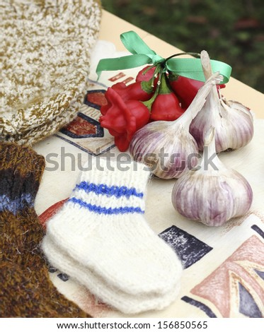 preparing for winter - woolen knitted baby socks and organic grown garlic
