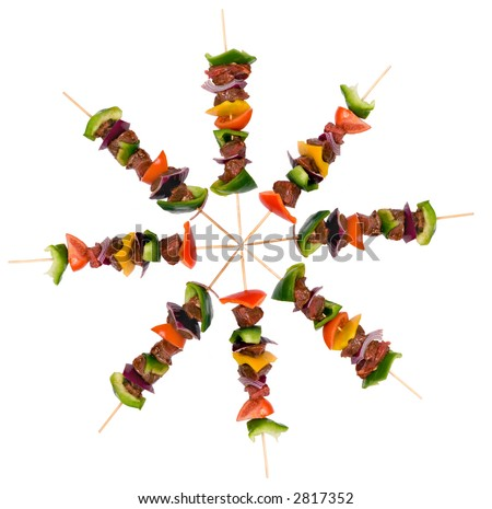 Preparing fresh beef steak shishkabobs with vegetables ready for the grill. Isolated - stock photo