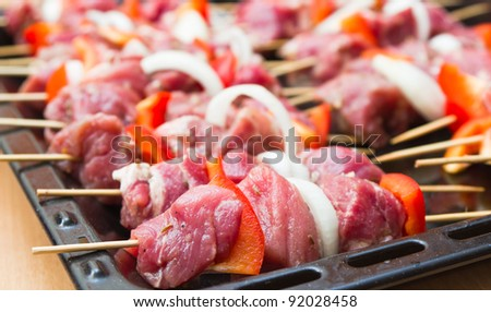 Preparing fresh beef steak with vegetables ready for the grill - stock photo