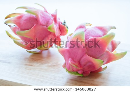 Preparing fresh couple red dragon fruits. - stock photo