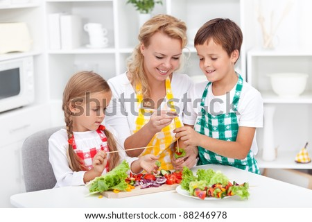 Preparing fresh food with the kids - healthy eating education - stock photo