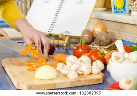Preparing fresh meal in the kitchen - stock photo